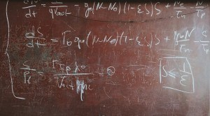 mathematical formula written in chalk on blackboard